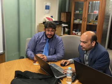 Nasirul Islam meets with Mohammad Abo Qadah, Ta'allum Schools School Improvement Consultant for Arabic subjects, for a performance data discussion.